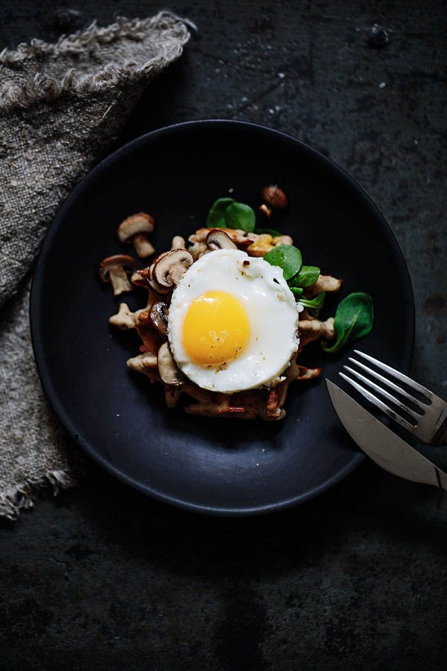Herbal waffles with greens, champignons and fried egg by Marta Greber